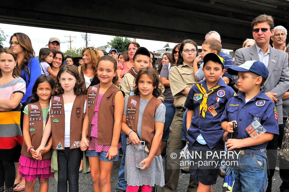 Members of Girl Scouts of America Brownie Troop 2272, Boy Scouts, and others at Merrick Fire Department ceremony commemorating 10th Anniversary of 9/11, held at corner of Merrick Avenue and Sunrise Highway, in Merrick, New York, USA, on September 11, 2011. Brownie Troop 2272 is responsible for keeping the memorial area clean every day of the year.
