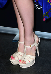(Shoe detail) Model Kelly Brook launches her new fragrance at The Perfume Shop on Oxford Street, London, UK. Monday, 17th March 2014. Picture by Nils Jorgensen / i-Images