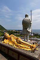 Statue of Kukai - There are several monuments to Kukai in Muroto, the most obvious being a giant white statue of him as a young man. In this depiction has a stern expression, and the white contrasts starkly with the green mountain behind it. The temple below the statue is used for training new priests.  A few meters further down the coastline are the caves in which he lived and medicated, a local Muroto attraction.