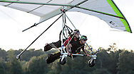 Emmanuelle Dimarsky, top, and hang glider pilot Thomas Atkins take off while being towed by an ultralight aircraft at Randall Airport in Middletown on Friday, Aug. 23, 2013. The hang glider rides are run by Hangar 3.