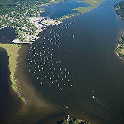 Boats moored in the Connecticut River in Essex, Connecticut.  Aerial.