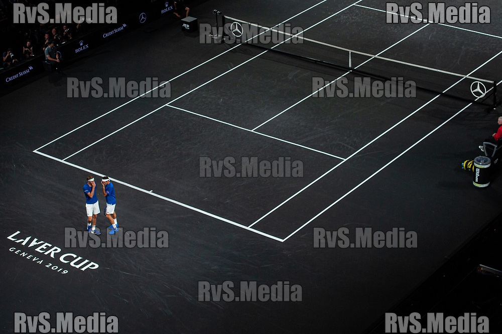 GENEVA, SWITZERLAND - SEPTEMBER 20: Roger Federer and Alexander Zverev of Team Europe prepares to serve during Day 1 of the Laver Cup 2019 at Palexpo on September 20, 2019 in Geneva, Switzerland. The Laver Cup will see six players from the rest of the World competing against their counterparts from Europe. Team World is captained by John McEnroe and Team Europe is captained by Bjorn Borg. The tournament runs from September 20-22. (Photo by Robert Hradil/RvS.Media)