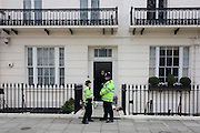 Metropolitan police officers guard the Belgravia home of the recently-deceased Baroness Margareth Thatcher, days after her death from a stroke at age 87. Her Chester Square house was Lady Thatcher's home from 1991 until she moved into the Ritz hotel in London at Christmas following an operation.