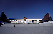 A giant bronze statue of Kim Il Sung dominates a Pyongyang hilltop, surrounded by socialist realistic sculptures.