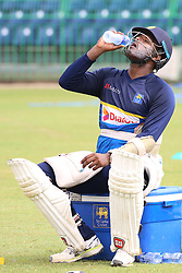 July 6, 2018 - Sri Lanka - Sri Lanka All-round cricketer Angelo Mathews is drinking water at practice session in the R.Premadasa Stadium in Colombo on July 6, 2018. Sri lanka and South Africa will play two Tests, five 50-over One-Day Internationals (ODIs), and one T20 in Sri Lanka between July 12 and August 14. The first Test between South African and Sri Lanka will be played on July 12 at the Galle International Cricket Stadium in Galle. (Credit Image: © Lahiru Harshana/Pacific Press via ZUMA Wire)