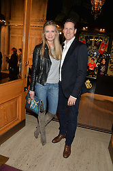 BRENDAN COLE and his wife ZOE HOBBS at the opening night of Cirque du Soleil's award-winning production of Quidam at the Royal Albert Hall, London on 7th January 2014.