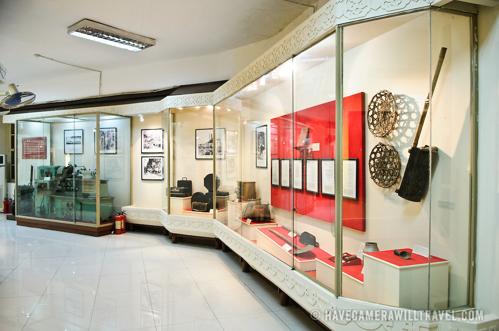 Agricultural and technological artefacts in glass exhibit cases. The Museum of the Vietnamese Revolution in the Tong Dan area of Hanoi, not far from Hoan Kiem Lake, was established in 1959 and is devoted to the history of the socialist revolutionary movement in Vietnam.