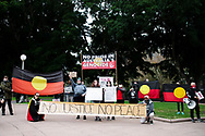 Protesters holding up signs at Hyde Park during a 'Black Lives Matter' rally on 02 June, 2020 in Sydney, Australia. This event was organised to rally against aboriginal deaths in custody in Australia as well as in unity with protests across the United States following the killing of an unarmed black man George Floyd at the hands of a police officer in Minneapolis, Minnesota. (Photo by Steven Markham/ Speed Media)