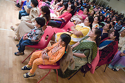 An audience watching a performance celebrating Diwali; Festival of Light,