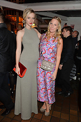 Left to right, PORTIA FREEMAN and ALICE NAYLOR-LEYLAND at the YSL Beauty: YSL Loves Your Lips party held at The Boiler House,The Old Truman Brewery, Brick Lane,London on 20th January 2015.