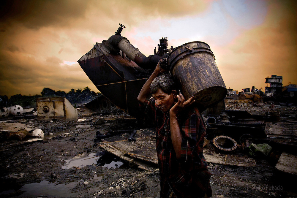Ship Yard Workers in Bangladesh<br /> A labor works in a ship breaking yard in Chittagong, Bangladesh.