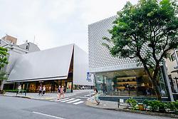 Modern architecture of fashion boutiques Miu Miu and Stella McCartney in upmarket Aoyama district of Tokyo Japan