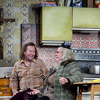 Gregor Fisher as 'Yer Granny' and Paul Riley.<br /> <br /> Yer Granny - a new production by The National Theatre of Scotland opens at the Beacon arts Centre, Greenock, Scotland.<br /> <br /> <br /> Based on La Nona by Roberto Cossa<br /> In a new version by Douglas Maxwell<br /> Directed by Graham McLaren<br /> <br /> <br /> Picture by Drew Farrell<br /> Tel : 07721-735041<br /> Image offered on a speculative basis.<br /> <br /> Yer Granny is a riotous new comedy about a diabolical 100-year-old granny who's literally eating her family out of house and home. She's already eaten their fish and chip shop into bankruptcy and now she's working her way through their kitchen cupboards, pushing the Russo family to desperate measures just to survive beyond 1977.<br /> <br /> As proud head of the family, Cammy is determined that The Minerva Fish Bar will rise again and that family honour will be restored – and all in time for the Queen's upcoming Jubilee visit. But before Cammy's dream can come true and before Her Maj can pop in for a chat, a single sausage and a royal seal of approval, the family members must ask themselves how far they will go to solve a problem like Yer Granny.<br /> <br /> Adapted from the smash-hit Argentinian comedy classic La Nona, the cast of Yer Granny features some of Scotland's best-loved performers, including Gregor Fisher in the title role, alongside Paul Riley (Still Game), Jonathan Watson (Only An Excuse?), Maureen Beattie (Casualty), Barbara Rafferty (Rab C Nesbitt), Brian Pettifer (The Musketeers) and Louise McCarthy (Mamma Mia!, West End).<br /> <br /> Performance dates :<br /> The Beacon Arts Centre, Greenock<br /> 19/05/2015-21/05/2015 <br /> <br /> King's Theatre, Glasgow<br /> 26/05/2015-30/05/2015 <br /> <br /> King's Theatre, Edinburgh<br /> 02/06/2015-06/06/2015 <br /> <br /> Eden Court, Inverness<br /> <br /> Lyric Theatre, Belfast<br /> 23/06/2015-27/06/2015 <br /> <br /> Dundee Rep Theatre<br /> 30/06/2015-04/07/2015
