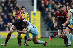 Saracens Number 8 (#8) Ernst Joubert (capt) is tackled by Northampton replacement (#18) Paul Doran Jones during the second half of the match - Photo mandatory by-line: Rogan Thomson/JMP - Tel: Mobile: 07966 386802 30/12/2012 - SPORT - RUGBY - stadiummk - Milton Keynes. Saracens v Northampton Saints - Aviva Premiership.