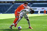 Portsmouth FC defender Charlie Daniels (21) battles for possession  with Milton Keynes Dons defender (on loan from Manchester United) Ethan Laird (12) during the EFL Sky Bet League 1 match between Milton Keynes Dons and Portsmouth at stadium:mk, Milton Keynes, England on 17 April 2021.