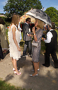 Ella Harris and Elizabeth Aitken. ( Harris) Marriage of Emilia Fox to Jared Harris. St. Michael's and All Angels. Steeple. Nr. Wareham. Dorset. 16 July 2005. ONE TIME USE ONLY - DO NOT ARCHIVE  © Copyright Photograph by Dafydd Jones 66 Stockwell Park Rd. London SW9 0DA Tel 020 7733 0108 www.dafjones.com