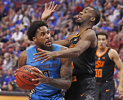 December 16, 2017 - Sunrise, FL, USA - Florida State's Phil Cofer (0) attempts to shoot as Oklahoma State's Tavarius Shine defends during the Orange Bowl Basketball Classic at the BB&T Center in Sunrise, Fla., on Saturday, Dec. 16, 2017. Oklahoma State won, 71-70. (Credit Image: © Al Diaz/TNS via ZUMA Wire)