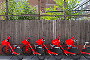 Available electric Uber Jump bikes are lined up on the pavement on Goswell Roak in Clerkenwell, on 29th July 2019, in London, England. JUMP bikes are pedal-assist electric bikes with integrated GPS and lock so users can find a bike nearby.