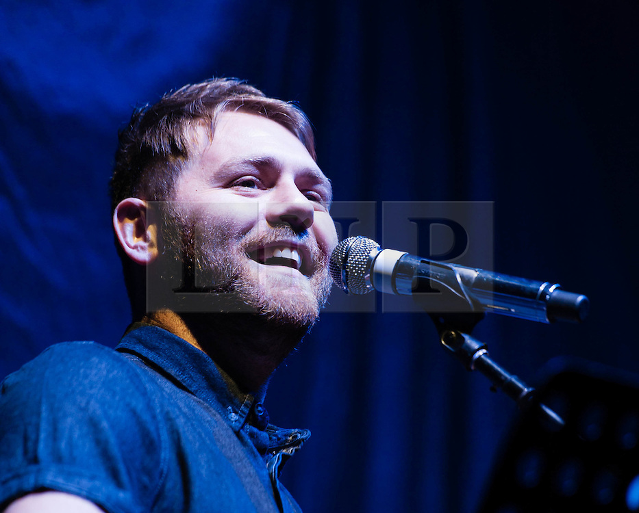 """© Licensed to London News Pictures. 26/01/2013. London, UK.   Brian McFadden performing live at The O2 Arena, supporting headliner Ronan Keating.    Brian Nicholas McFadden (born 12 April 1980) is an Irish singer-songwriter who rose to fame in the late 1990s as a member of the Irish boyband Westlife.   This is the first time performing in the UK for seven years, and Brian released his fourth studio album, """"The Irish Connection"""" in 2012 which was only released in Australia.  Photo credit : Richard Isaac/LNP"""