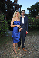 ANTHONY DE ROTHSCHILD and TANIA STRECKER at a Summer party hosted by Lady Annabel Goldsmith at her home Ormeley Lodge, Ham, Surrey on 14th July 2009.