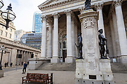 A man waits on the street in front of the Royal Exchange next to the Bank of England left in what would normally be the morning rush hour in the City of London on March 17th, 2020. The financial district of the UK is unusually quiet after the government requested people to refrain from all but essential travel and activities yesterday.