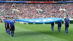 MOSCOW, June 14, 2018  Chinese caddies enter into the field holding a FIFA flag before the opening match of the 2018 FIFA World Cup in Moscow, Russia, on June 14, 2018. (Credit Image: © Yang Lei/Xinhua via ZUMA Wire)