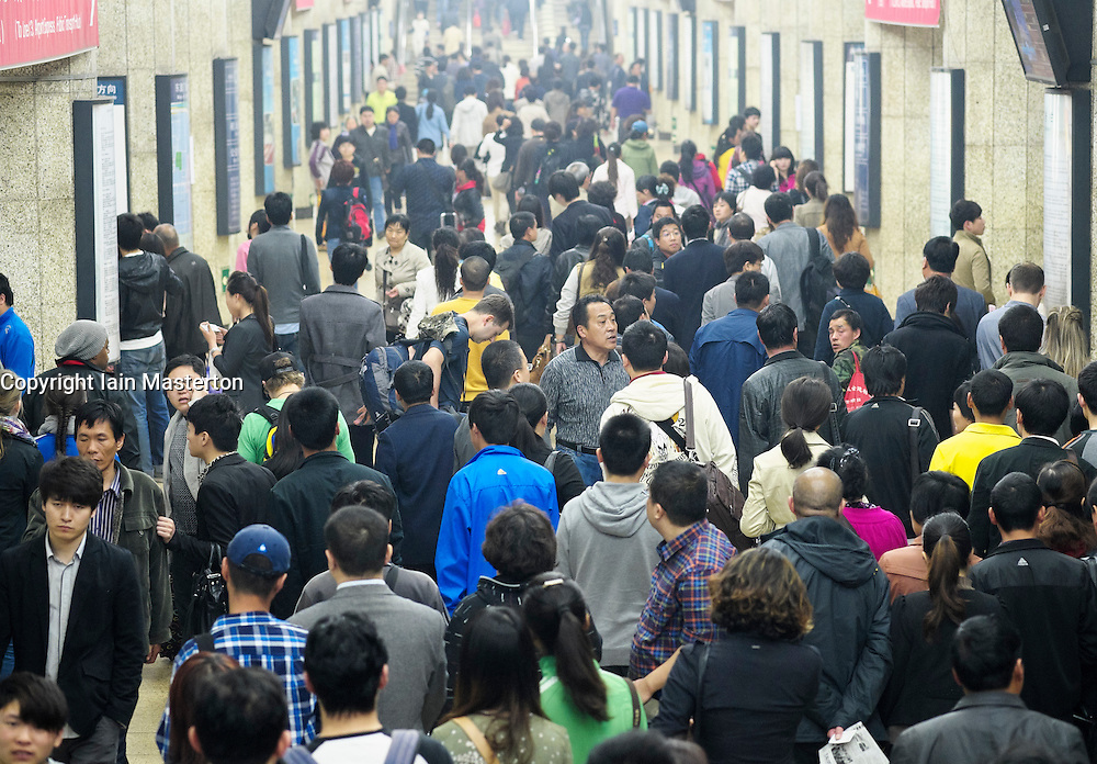 Busy platform at station on the Beijing subway system in China