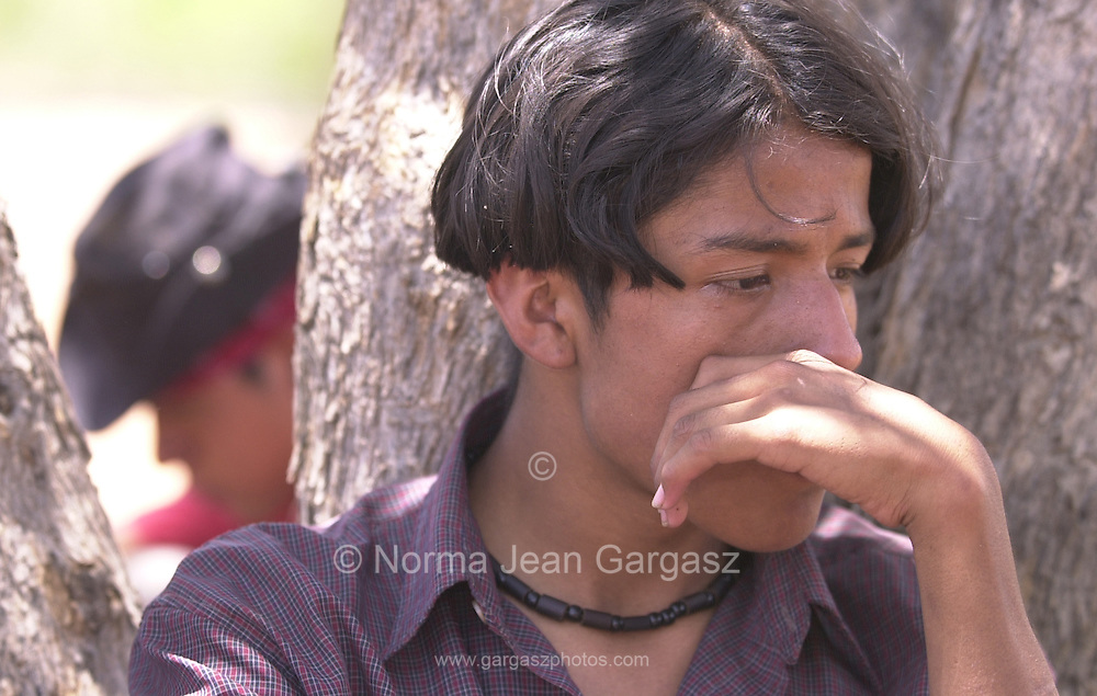 Carlos Hernandez Juarez, 18, waits to be processed by the Border Patrol after a helicopter pilot spotted his family east of Sells and south of Route 86.  The group that included his 6-year-old nephew walked the West Desert on the Tohono O'odham for about 24 miles.  (PHOTO: NORMA JEAN GARGASZ)