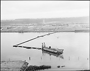 "Ackroyd 10971-2 ""Port  of Portland. Swan Island aerial. June 8, 1962"" (dredging Gunderson material across Willamette to Swan Island)"