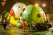 New York, NY – 27 November 2019. Thousands of spectators packed the streets around the American Museum of Natural History to see the inflation area for the balloons for Macy's Thanksgiving Day Parade. A few children get a close-up tour of the balloons, including the Wimpy Kid.