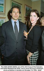 The HON.HENRY SMITH, son of the 4th Viscount Hambleden, and MISS FRANCES DE SALIS, niece of the Duchess of Norfolk,  at an exhibition in London on October 1st 1996. LSL47