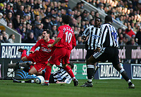 Photo. Andrew Unwin, Digitalsport<br /> Newcastle United v Liverpool, Barclays Premiership, St James' Park, Newcastle upon Tyne 05/03/2005.<br /> Liverpool's Steve Finnan (L) feels the pain as he's fouled by Newcastle's Laurent Robert