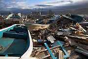Debris of ruined boats is senn on the ground nerby a fishing port in Minamisanriku town.