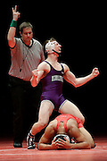 Jacob Covaciu, of Merrillville, in purple, after defeating Steven Lawrence of Portage, in red, in the 145-pound class  during the 2015 IHSAA state wrestling finals in Indianapolis, Saturday, Feb. 21, 2015. (Photo by AJ Mast)