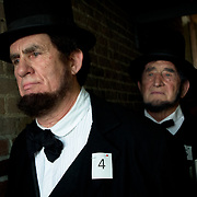 John King, left, and Douglas Kirkland prepare themselves for the Abraham Lincoln look-alike contest at the Shriver House Museum in Gettysburg, PA, during the Sesquicentennial Anniversary of the Battle of Gettysburg on Wednesday, July 3, 2013.  John Boal Photography