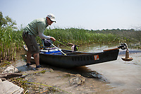 angler and guide Drew Price rigs up the canoe for a day of fly fishing on lake champlain