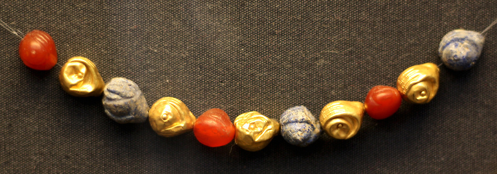 Ancient Greek 'Palace Age' Minoan necklace. Circa 1850-1550 BC. Made with beads of amethyst and cornelian. From the Aegina treasures held at the British Museum, London. Originally from Aegina, off the south coast of Greece.