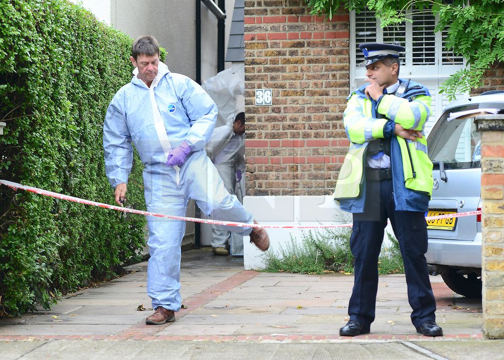 © Licensed to London News Pictures. 30/08/2012. London, UK A scenes of crimes officer leaves the house. A street cleaner has suffered potentially life threatening after being stabbed when disturbing a burglary in Shepherds Bush in West London today 30 August 2012. Photo credit : Stephen Simpson/LNP