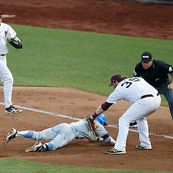 Jun 24, 2013; Omaha, NE, USA; Mississippi State Bulldogs first baseman Wes Rea (35) tags out UCLA Bruins right fielder Eric Filia (bottom) during the fourth inning in game 1 of the College World Series finals at TD Ameritrade Park. Mandatory Credit: Derick E. Hingle-USA TODAY Sports