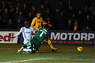 Newport's Christian Jolley has a shot blocked by Wimbledon keeper Ross Worner . Skybet football league 2, Newport county v AFC Wimbledon match at Rodney Parade in Newport, South Wales on Tuesday 25th Feb 2014.<br /> pic by Andrew Orchard, Andrew Orchard sports photography.