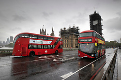 © Licensed to London News Pictures. 28/04/2020. London, UK. Buses come to a standstill on Westminster Bridge to observe a minute's silence in memory of key workers who have died during the pandemic. More than 100 medical NHS workers and care staff have died from the Covid-19 virus in the UK. Also many other key workers and transport staff have died. The public have been told they can only leave their homes when absolutely essential, in an attempt to fight the spread of coronavirus COVID-19 disease. Photo credit: Peter Macdiarmid/LNP