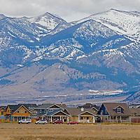 New houses replace farm fields below the Bridger Mountains near Bozeman, Montana.
