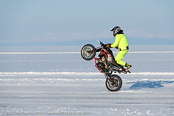 Doing a wheelie down the mile long track at the Baikal Mile Ice Speed Festival. Maksimiha, Siberia, Russia. Friday, February 28, 2020. Photography ©2020 Michael Lichter.