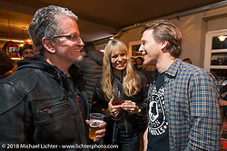 Ray Drea and Karen Davidson of Harley-Davidson chat with Ingo Riedeberger of Intermot at the Mr. Martini Friday night party celebrating the opening of his bar / restaurant at the workshop during the Mr. Martini Friday night party celebrating the opening of his bar / restaurant at the workshop during the Motor Bike Expo. Verona, Italy. January 22, 2016.  Photography ©2016 Michael Lichter.