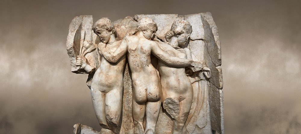 Close up of a Roman Sebasteion relief  sculpture of the Three Graces, Aphrodisias Museum, Aphrodisias, Turkey.  <br /> <br /> The Three Graces stand in their familiar hellenistic composition. They were handmaids of Aphrodite and appeared in this form on the decoration of her cult statue at Aphrodisias. Their names evoked their character: Euphrosyne (joy), Aglaia (Splendour) and Thaleia (Bloom). .<br /> <br /> If you prefer to buy from our ALAMY STOCK LIBRARY page at https://www.alamy.com/portfolio/paul-williams-funkystock/greco-roman-sculptures.html . Type -    Aphrodisias     - into LOWER SEARCH WITHIN GALLERY box - Refine search by adding a subject, place, background colour, museum etc.<br /> <br /> Visit our ROMAN WORLD PHOTO COLLECTIONS for more photos to download or buy as wall art prints https://funkystock.photoshelter.com/gallery-collection/The-Romans-Art-Artefacts-Antiquities-Historic-Sites-Pictures-Images/C0000r2uLJJo9_s0