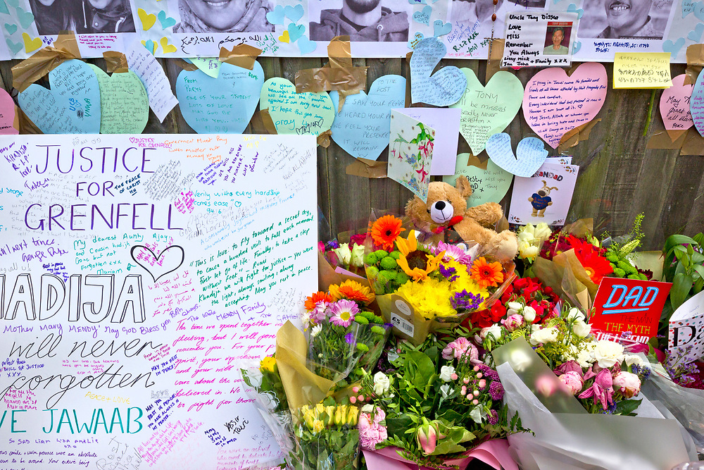18 July 2017 taken between the hours of 15.51 - 16.49<br /> <br /> Grenfell Tower's memorial wall of hope. Showing both the grief and anger of the community.<br /> <br /> The Grenfell Tower fire occurred on 14 June 2017 at the 24-storey, 220-foot-high (67 m), tower block of public housing flats in North Kensington, Royal Borough of Kensington and Chelsea, West London. It caused at least 80 deaths and over 70 injuries. A definitive death toll is not expected until at least 2018. As of 5 July 2017, 21 victims had been formally identified by the Metropolitan Police. Authorities were unable to trace any surviving occupants of 23 of the flats. (Source Wikipedia}