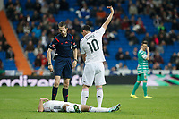 Real Madrid´s James Rodriguez calls the medical services after Sami Khedira got injured during Spanish King Cup match between Real Madrid and Cornella at Santiago Bernabeu stadium in Madrid, Spain. May 26, 2013. (ALTERPHOTOS/Victor Blanco)