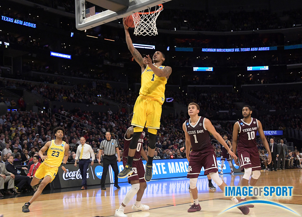 Michigan Wolverines guard Charles Matthews (1) shoots the ball against the Texas A&M Aggies during a West Regional semifinal of the NCAA men's college basketball tournament, Thursday, March 22, 2018, in Los Angeles. Michigan defeated Texas A&M 99-72.