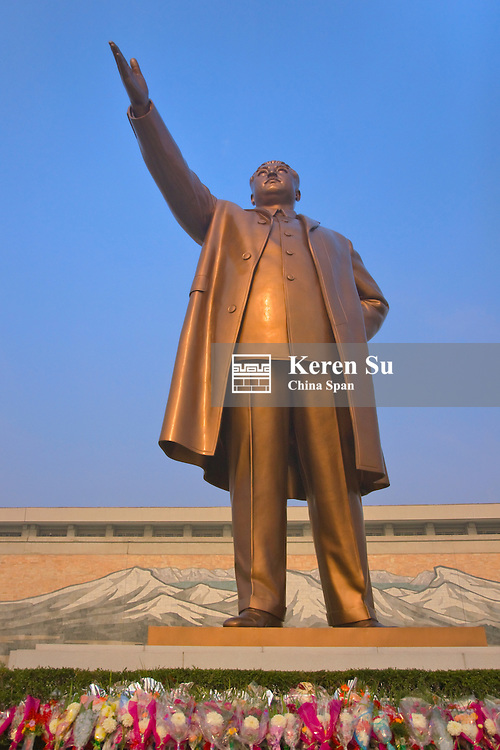 Bronze statue of former President Kim Il-Sung and Mansudae Assembly Hall, Mansu Hill, Pyongyang, North Korea