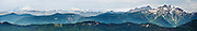 Mount Baker, Mount Shuksan, and Three Fingers rise high above verdant Mount Baker-Snoqualmie National Forest, Washington, USA. Mount Pilchuck State Park offers a great day hike of 6 miles and 2300 feet vertical gain to a former fire lookout providing sweeping views of the Central Cascades. Panorama stitched from 8 images.